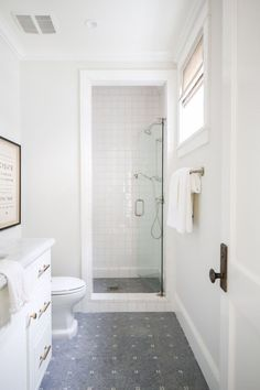 Clean white bathroom with interesting tile