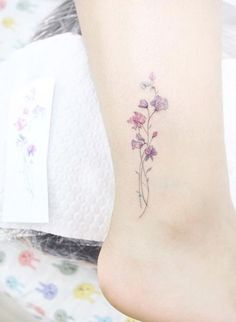 Even if you're not a tattoo person, it's easy to fall in love with tiny flower tattoos as they're just beautiful and make jewellery seem boring.