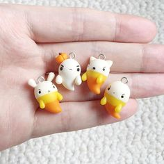 Made some candy corn ghosts!!!! One is a bunny ghost and one is a cat ghost