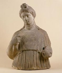 An ancient Greek memorial stone shows the deceased holding a pomegranate, symbol of death & fertility, in her left hand; she holds a pet bird in her right hand. (Kunsthistorisches Museum Vienna)