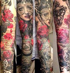 Stunning Masquerade Tattoo by Ellen Westholm .