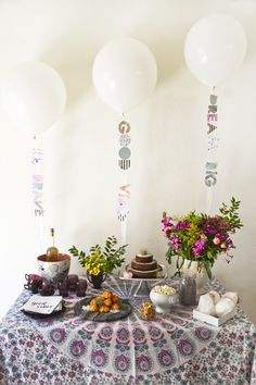 """Baby Shower Table. The letters on the strings attached to the balloons say """"Be Brave,"""" """"Good Vibes"""" and """"Dream Big."""" Creative idea!"""