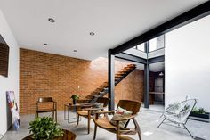Exposed Brick Walls Steal the Show in this Modern Industrial Home! Brick wall brings unique textural element to the living room Industrial Home Design, Industrial House, Modern Industrial, Modern Barn, Industrial Office, Vintage Industrial, Modern Farmhouse, Brick Architecture, Interior Architecture