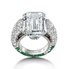 Emerald-cut diamond ring with emeralds designed by de GRISOGONO. The center contains a carat diamond with 211 white diamonds and 79 emeralds around the band. Sapphire Diamond Engagement, Platinum Engagement Rings, Emerald Cut Diamonds, Silver Diamonds, Modern Jewelry, Fine Jewelry, Luxury Jewelry, Custom Jewelry, Jewelry Rings