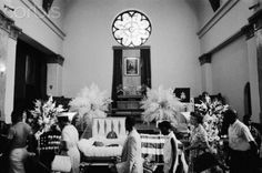 Mourners pay their respect to slain civil rights leader, Medgar Evars in 1963. His killer was finally convicted in 1994.