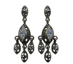 Light up your look in decorative sterling silver Judith Jack blue topaz earrings, intricately designed with marcasite.