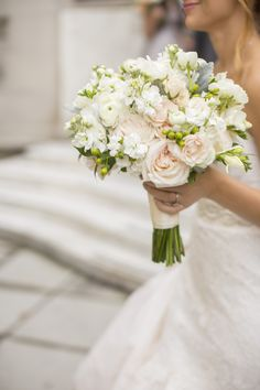 Erin held a textured, feminine bouquet that included blush garden roses, dusty miller, hypericum berries and ranunculus.