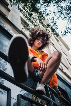 Low Angle View of a Woman Sitting on Handrail · Free Stock Photo Human Photography, Perspective Photography, Portrait Photography Poses, Photography Poses Women, Photo Poses, Creative Photography Poses, Teenage Girl Photography, Urban Fashion Photography, Instagram Gallery