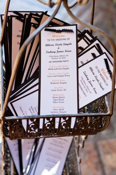 Black & white paper programs with orange accents & black ribbon | David De Dios Photography | villasiena.cc