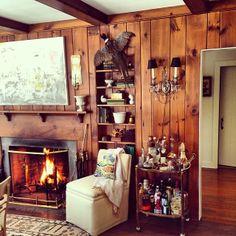 Eddie Ross: knotty pine paneling, bookshelves, pheasant