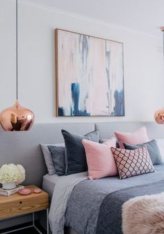 Bedroom inspiration for a great and pink Blush scheme with copper, textures and coloured cushion in grey, pink and pattern.