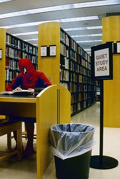 spiderman reading  - how cool would this be in the library and all the adults just act casual