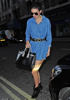 Jean Genie:The 19-year-old model sported a stylish collared denim minidress as she made h...