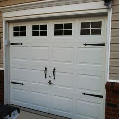 Faux garage windows after.... They're painted on!