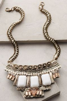 "Tantalize Bib Necklace - anthropologie.com - $88 Metal, plastic, glass w/ Lobster clasp 22.5"" L w/ 3"" Bib"