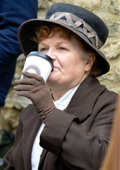 Mrs. Patmore takes a sip of coffee cup on the set of 'Downton Abbey' season 5.