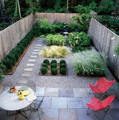 """The patio was constructed with 2' x 2' bluestone tiles 1.5"""" thick, the path using 1.5' x 1' tiles of the same stone; about $12/square foot. beautiful backyard makeover"""