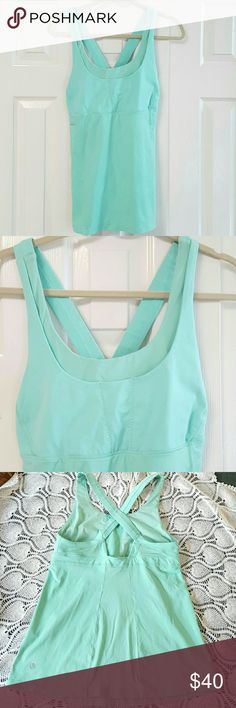 Lululemon Cross Strap Tank *No trades, for offers please use the offer button* Gently washed and worn. No rips or stains that I can see. *Built in shelf bra *Not padded  *Turquoise blue color lululemon athletica Tops Tank Tops