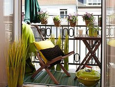 Green themed balcony - love the small plant baskets on the railing!  #balcony #beautiful #amazing #green #chic #design #inspiration