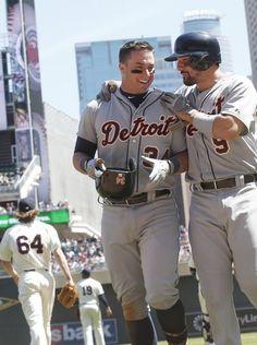 Detroit Tigers' James McCann, left, is congratulated