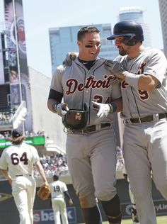 Detroit Tigers' James McCann, left, is congratulated