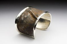 found rusted metal, bracelet. sterling silver and rusted steel by Matthieu Cheminee