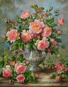 Roses in a silver vase, so perfect together.