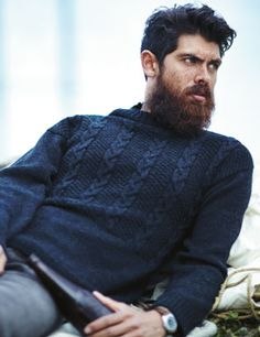 Lovely knit men's sweater. Though I'd knit the cables from top to bottom
