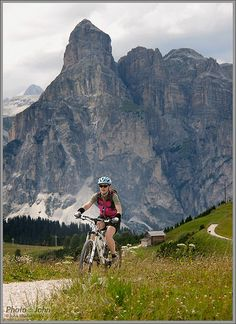 Jenni, mountain biking in the Dolomites. This particular ride was mostly sucky fire roads. But the scenery made it glorious, anyway.         See Italy from the inside! Check this out: http://vzturl.com/hb52