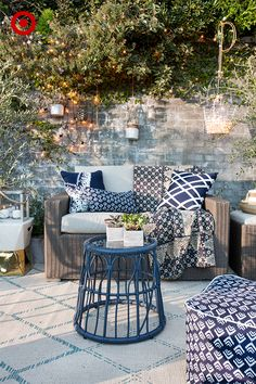 Bring the indoors outside. Target Home Style Expert, Emily Henderson, created this living-room inspired patio using three simple and affordable updates. 1. Textiles: Soften a space and make it more inviting by layering pillows, throws and fabrics. 2. Lighting: String lights and lanterns add ambiance—and everyone loves a little twinkle. 3. Plants: Large potted plants help define the area while smaller ones, like succulents, make for tabletop decor that's both chic and low-maintenance.