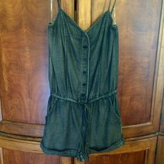 Adorable denim romper Adorable, lightweight denim Lila romper from Flying Tomatoe.  Multiple sizes available, from my boutique inventory.  Has string belt and elastic waist.  85% cotton, 15% polyester Flying Tomato Shorts