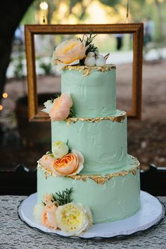 Kara Donovan Photography www.karadonovan.com Rustic chic teal blue wedding cake with gold leaf and flowers, picture frame