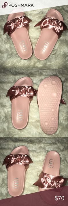 Pink Fenty Slides by Rihanna the FENTY PUMA by Rihanna Bow Slide features a beautiful satin bow and a satin foam backing.   FENTY PUMA by Rihanna emblazoned on footbed.  Never worn   Size 5 (but in USsize it fits for an 8) Rihanna Shoes Slippers