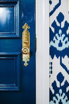 // Navy high gloss door + brass knob. ♥️