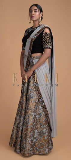 Buy Online from the link below. We ship worldwide (Free Shipping over US$100)  Click Anywhere to Tag Grey And Gold Lehenga In Brocade With Embroidered Blouse And Pre Stitched Dupatta Online - Kalki Fashion Grey and gold lehenga featuring brocade silk.Matched with black blouse in velvet.Enhanced in cold shoulder with armhole embellished in resham, moti work in floral motif and sleeve in cut dana embroidery in Moroccan motif Saree Blouse, Sari, Gold Lehenga, Indian Fashion, Women's Fashion, Grey And Gold, Designer Sarees, Indian Designer Wear, Embroidered Blouse