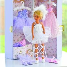 "On-Tour Musical Ballerina by CP Toys. $35.99. Doll is 11"" H. with jointed arms and legs 5 1/2"" sq. x 12"" H.. trunk has a music box Includes 3 costumes. This exquisite ballerina comes complete with 3 gorgeous costumes. She travels secured in a sturdy trunk that has a music box. The 10½"" H. vinyl doll has jointed legs and arms. Trunk is 5¼"" x 12"" H."
