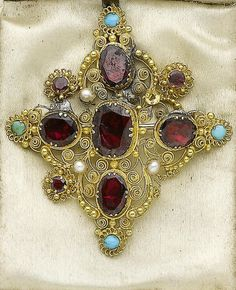 A gold cannetille garnet, turquoise and seed pearl demi-parure, circa 1820  Of floral design, the necklace set with oval, pear and circular-cut garnets, circular cabochon turquoise and seed pearls, in foiled closed-back settings, accompanied by a pair of bracelets, a pair of pendent earrings and a brooch  en suite. [Detail of cannettile]