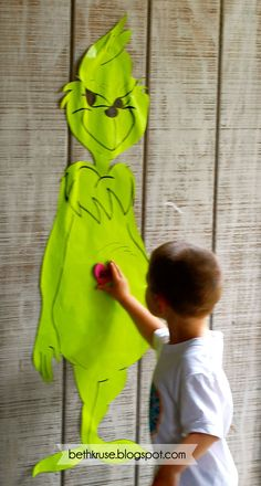 Pin the heart on Mr. Grinch!  Perfect Christmas party game <3