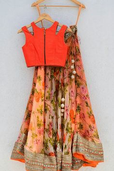 Georgette Party Wear Lehenga Choli in Orange and Green Colour Georgette Party Wear Lehenga Choli in Orange and Green Colour.It comes with matching Dupatta and Choli.It is crafted with Printed… Lehenga Designs, Saree Blouse Designs, Party Wear Lehenga, Red Lehenga, Anarkali, Floral Lehenga, Lehenga Blouse, Lehenga Wedding, Ghagra Choli