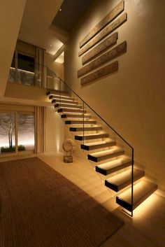 If we talk about the staircase design, it will be very interesting. One of the staircase design which is cool and awesome is a floating staircase. This kind of staircase is a unique staircase because Staircase Lighting Ideas, Stairway Lighting, Floating Staircase, Modern Staircase, Staircase Design, Corridor Lighting, House Lighting, Hall Lighting, Stair Design