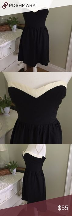 """Parker Black & White Strapless High Low Silk Dress This strapless black and white dress from Parker is 100% silk. It features white trim around a sweetheart neckline, back zipper, elastic back and high low skirt: high in front, low in the back. Size: Small (but fits like an XS). Chest: 13.5"""". Waist: 11.75"""". Length (front): 26"""". Length (back): 32.5"""". #0089 Parker Dresses High Low"""