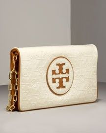 Seen a lot of Tory Burch clutches in this style, but this one is so chic!