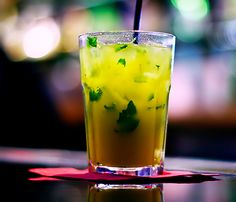 Mango Mojito - 1 1/2 oz Cruzan® mango rum, 3 oz club soda,  4 mint leaves,  1 lime wedge  (Muddle the mint leaves and lime wedge in the bottom of an old-fashioned glass. Add Cruzan mango rum and club soda as above or adjusted to taste. Add ice cubes, and serve.)
