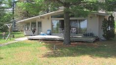 The Sweet Serenity Vacation Home has a beautiful screened porch with a marvelous view of Lake Huron.