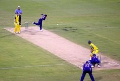 Sri Lanka Cricket: Those Smart Blue Uniforms: Muttiah Muralitharan bowling in a one day international against Australia.