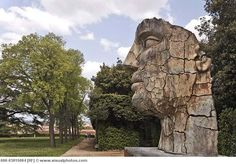 Face sculpture created by Igor Mitoraj in 1998, in the Boboli Gardens at Palazzo Pitti, Florence, Tuscany, Italy