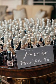 miniature bottles of prosecco with straws and 'thank you' notes as the favors for couples wedding