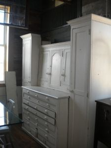 Very functional 4 piece set,   1 upper cabinet, 1 base with lots of flat file   storage and 2 armoire/pantry pieces. $1895