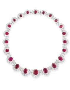 A FINE RUBY AND DIAMOND NECKLACE, BY BULGARI Designed as a graduated series of oval-shaped rubies each within the pear-shaped and brilliant-cut diamond half clusters, circa 1970, 41.4 cm. long Signed Bulgari
