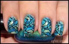Blue Stained Glass Nails.   Polishes used: Zoya Charla and Robyn. Orly Luxe, Stone Cold, and Green With Envy. The colors were dotted on the nail, then a thin coat of Orly Green with Envy was put on top of it all. Finally, Bundle Monster stamp 208 was put on top.